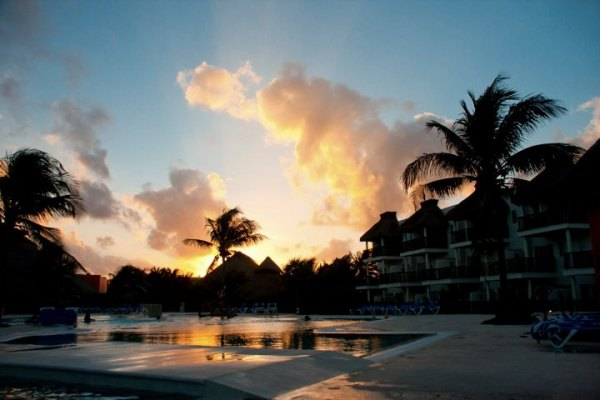 The hotel pool at sunset.