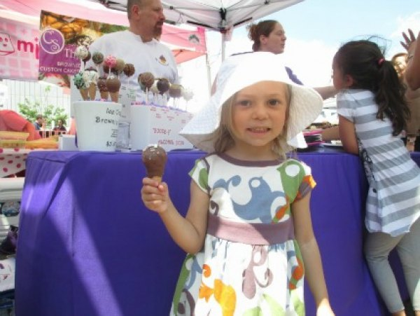 My daughter trying her first ever cake pop at LIC Flea & Food