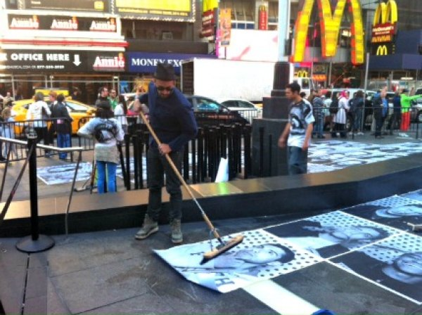 The whole point of the public art project is for the pics to be plastered to the Times Square sidewalk