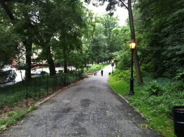 One of Fort Tryon Park's many tree-lined pathways; this one follows<br /> Broadway