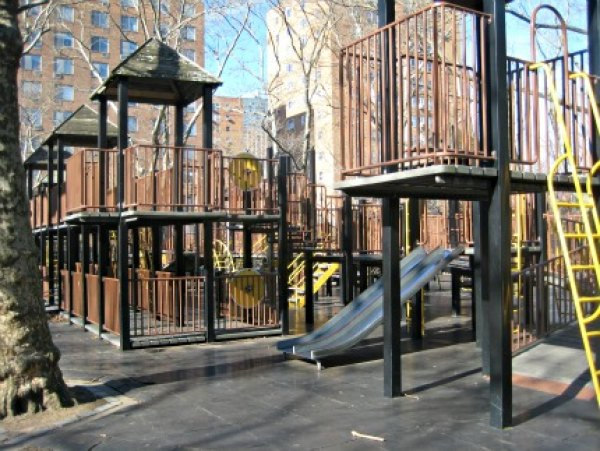 The big playground near St. Edwards Street has a fort-inspired double-decker<br /> play structure