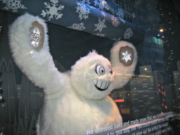 The yeti finally makes it to NYC and creates snowflakes for Saks Fifth Avenue's windows
