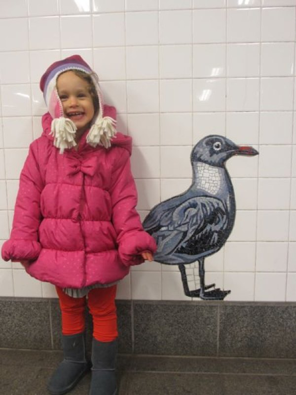 My daughter posing with a bird at the American Museum of Natural History's station