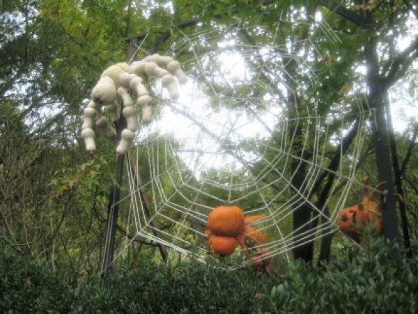 A spider and her prey at the New York Botanical Garden's Haunted Pumpkin Garden
